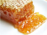 Raw honey combined with tea tree oil for acne treatment.